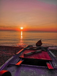 Fishing boat captured early in the morning with a beautiful sunrise