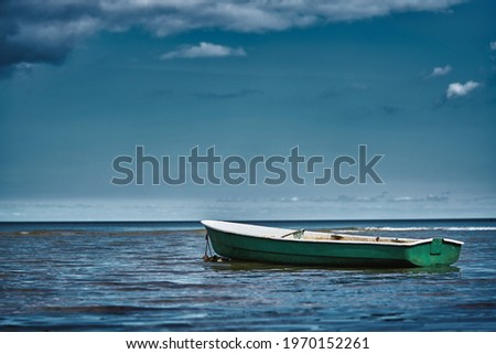 Fishing boat floating on the water, blue sea and sky with copy space Stock fotó ©