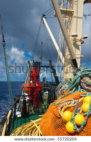 Fishing boat in blue atlantic ocean #55720204