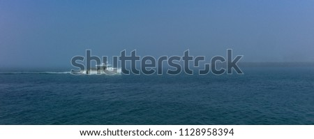 Fishing boat in clearing fog