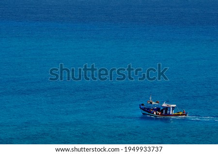 Fishing boat in the sea at the small uninhabited island of Chrysī also called Chrissi or Gaidouronīsi about 7 miles south of Crete near Ierapetra in the Libyan Sea.