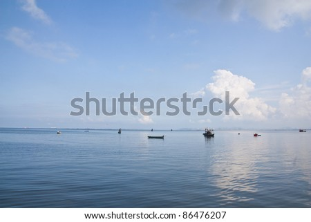 Fishing boat in the sea on blue sky background #86476207