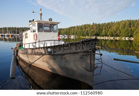 Fishing boat moored in the Imatra harbor, Finland