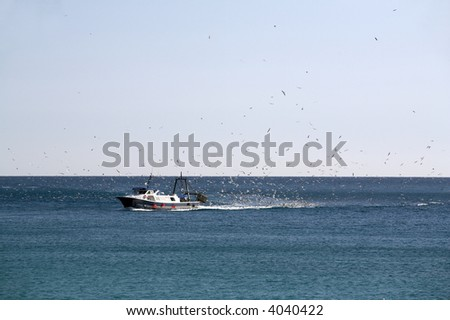Fishing boat moving at open sea