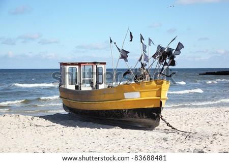 Fishing boat on Baltic Beach in Niechorze, Poland