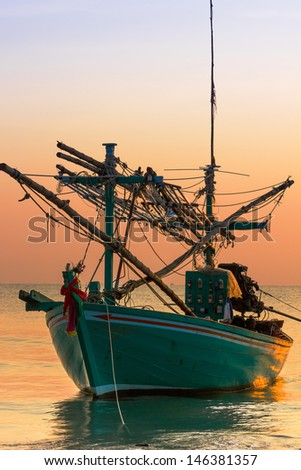 Fishing Boat on sunset  a background of  beautiful sunset