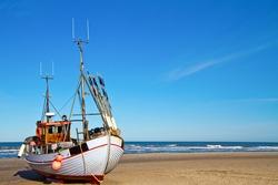 Fishing boat on the beach in Denmark