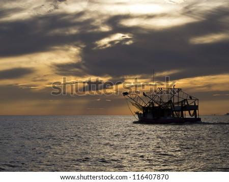 Fishing boat sailing into Gulfport Biloxi Sunset