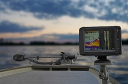 Fishing boat with fish finder, echolot, sonar and structure scaner aboard