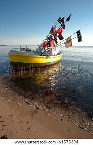 Fishing boat with flags on Baltic sea, Poland