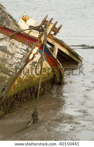 fishing boat wreck stranded in tidal mud