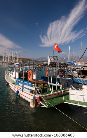 Fishing boats along the harbour front in Fethiye, Turkey.