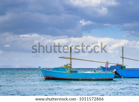 Fishing boats anchored at blue lagoon in Egyptian coastline - tradition sea crafts on Red Sea. Seaside view with fisherman motorboats and turquoise water. Marine landscape of Hurghada harbour. #1011572866