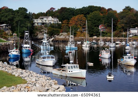 Fishing boats are docked in Perkins Cove, Maine in Autumn.