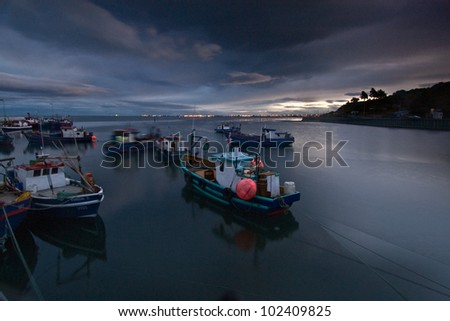 Fishing Boats at sunset in Patagonia, Chile