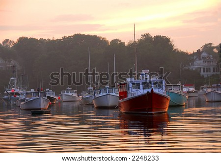 Fishing boats at sunset in Perkins Cove, Maine