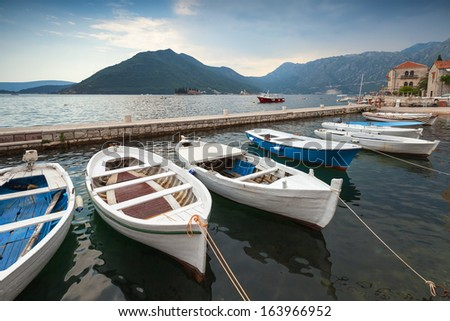 fishing boats float moored in...