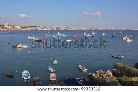 Fishing boats floating in the fish port of Cascais - Portugal