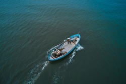 Fishing boats floating on the sea. Fishermans in boat. fishing boat sailing in open waters. man fishing on boat. sailing boat landscape