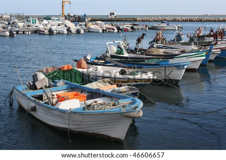 Fishing boats in Olhao's harbour in the Algarve, south coast of Portugal.