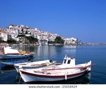 Fishing boats in the port os Skopelos a Greek island - stock photo