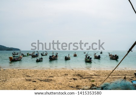 Fishing boats in the sea parked near the beach Near the international airport in Phuket, Thailand. #1415353580