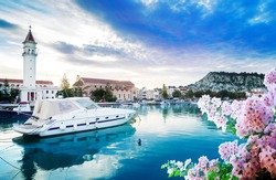 fishing boats in Zaante town harbor with flowers, Zakinthos Greece