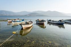 Fishing boats moored along the shore of Lake Bafa in Turkey.