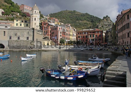 Fishing boats moored in the harbor of Vernazza.  Vernazza is one of the five villages that make up Cinque Terre.  Located on the rugged coast of the Italian Riviera in the Liguria region of Italy. - stock photo