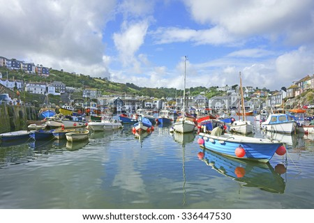 Fishing boats moored in the inner harbour at Mevagissey on a beautiful blue sky day, South Cornwall, England, United Kingdom