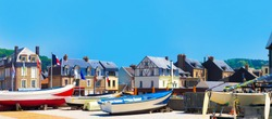 Fishing boats near country houses. Picturesque panoramic landscape beautiful city of Etretat of Normandy, France
