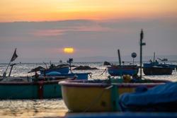 Fishing boats on Binh Thuan beach on the sunrise on Binh Thuan province, Vietnam