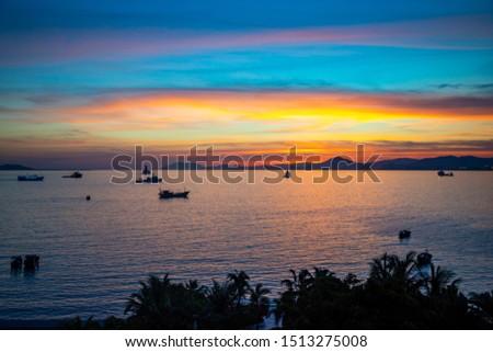 Fishing boats on sea in sunset lights in Sanya, Hainan in China