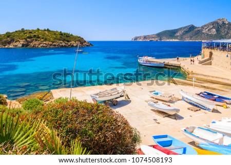 Fishing boats on shore in Sant Elm village, Majorca island, Spain