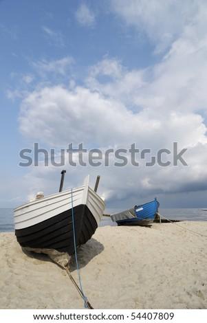 fishing boats on the beach - stock photo