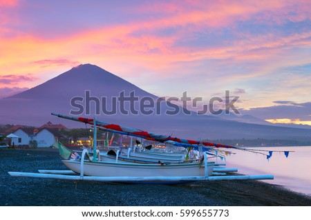 Fishing boats on the beach and Agung mountain on background. Amed, Bali island, Indonesia