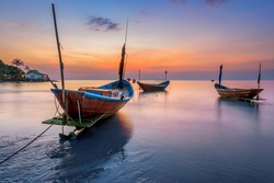 Fishing Boats on the Beach at sunset