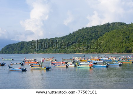 fishing boats parking near beach