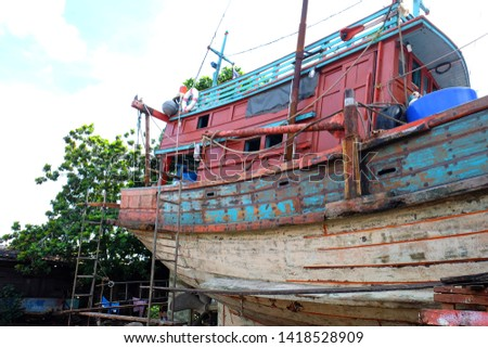 Fishing boats while being repaired #1418528909