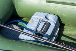 Fishing box with fishing rod and pump green boat.