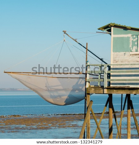 Fishing cabin and carrelet net, Medoc, France.
