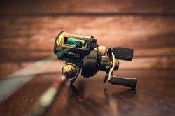 fishing casting reel on a rod with a cord