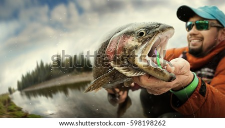 Fishing. Fisherman and trout. Dramatic.