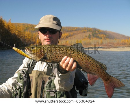 Fishing - fisherman with big trout