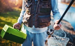 Fishing. Fisherman with fishing equipment. Sport, recreation concept