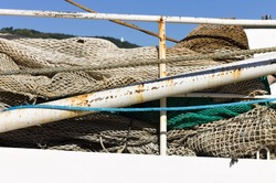 Fishing gear and items on an old white fishing boat (Pesaro, Italy, Europe)