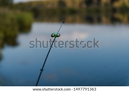 fishing gear. fishing rods. fishing rods standing on a fishing trip. landscape of a fisherman. camping. #1497791363