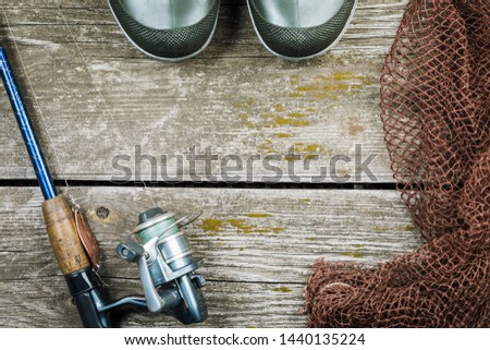 Fishing gear, hooks and baits on a wooden background. #1440135224