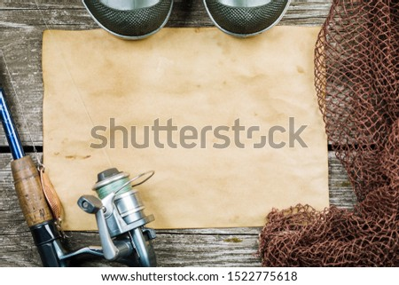 Fishing gear, hooks and baits on a wooden background. #1522775618