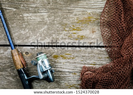 Fishing gear, hooks and baits on a wooden background. #1524370028